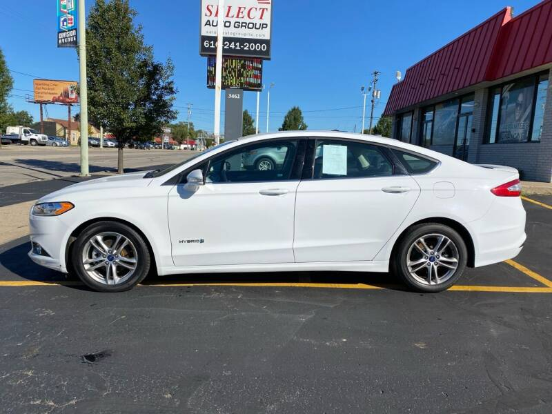 2015 Ford Fusion Hybrid for sale at Select Auto Group in Wyoming MI