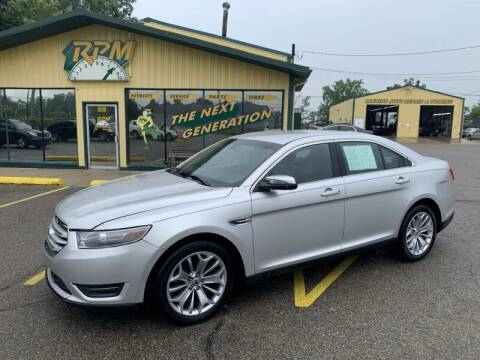 2013 Ford Taurus for sale at RPM AUTO SALES in Lansing MI