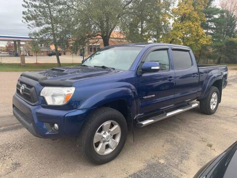2014 Toyota Tacoma for sale at Leonard Enterprise Used Cars in Orion MI