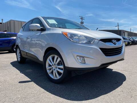 2013 Hyundai Tucson for sale at New Wave Auto Brokers & Sales in Denver CO