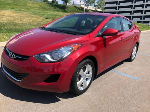 2013 Hyundai Elantra for sale at DRIVE N BUY AUTO SALES in Ogden UT