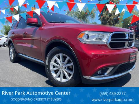 2014 Dodge Durango for sale at River Park Automotive Center in Fresno CA