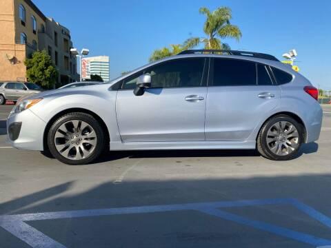 2014 Subaru Impreza for sale at CARSTER in Huntington Beach CA