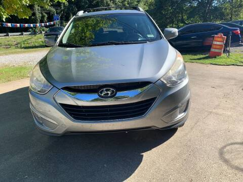 2013 Hyundai Tucson for sale at Day Family Auto Sales in Wooton KY