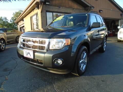 2009 Ford Escape for sale at IBARRA MOTORS INC in Cicero IL
