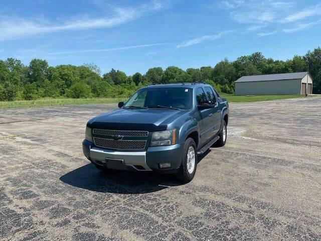 2009 Chevrolet Avalanche for sale at Caruzin Motors in Flint MI