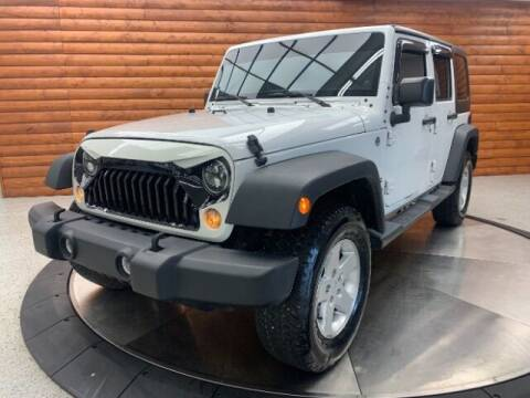 2014 Jeep Wrangler Unlimited for sale at Dixie Motors in Fairfield OH