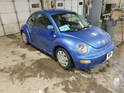 1999 Volkswagen New Beetle for sale at BERG AUTO MALL & TRUCKING INC in Beresford SD