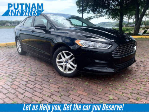 2016 Ford Fusion for sale at PUTNAM AUTO SALES INC in Marietta OH