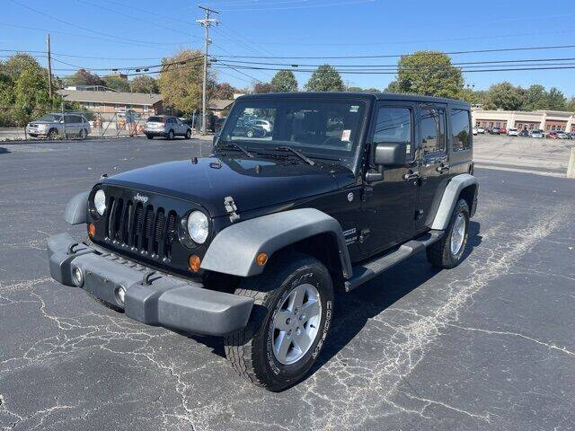 2012 Jeep Wrangler Unlimited for sale at MATHEWS FORD in Marion OH