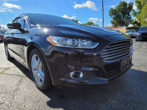 2016 Ford Fusion for sale at Dixie Automart LLC in Hamilton OH