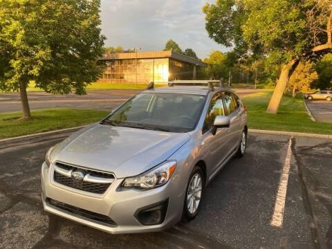 2014 Subaru Impreza for sale at QUEST MOTORS in Englewood CO
