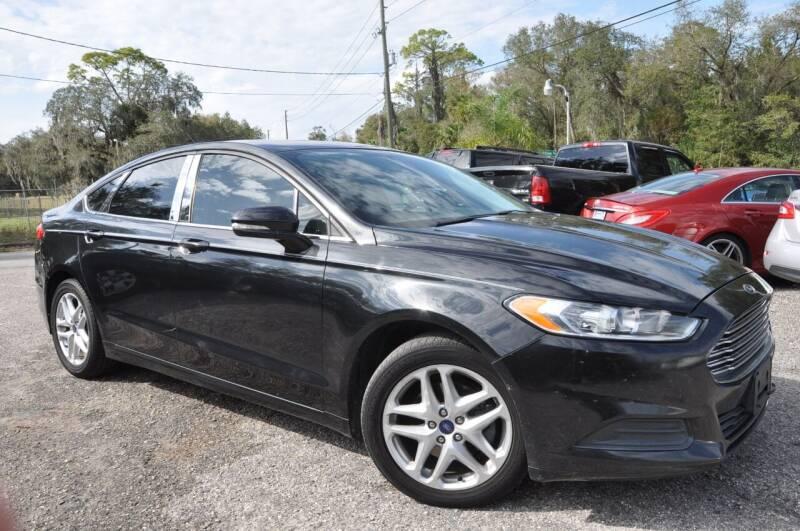 2013 Ford Fusion for sale at Elite Motorcar, LLC in Deland FL