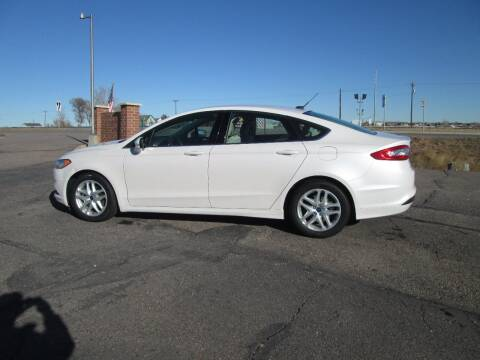 2014 Ford Fusion for sale at STEVES ROLLIN STONE AUTO SALES in Eaton CO