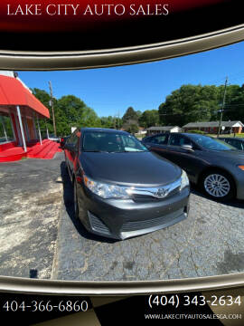 2012 Toyota Camry for sale at LAKE CITY AUTO SALES in Forest Park GA