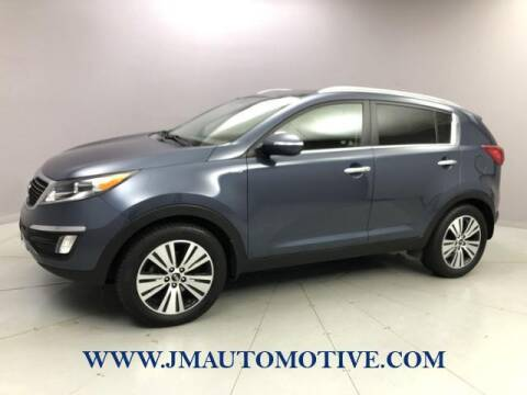 2015 Kia Sportage for sale at J & M Automotive in Naugatuck CT