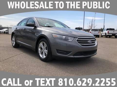 2014 Ford Taurus for sale at Lasco of Grand Blanc in Grand Blanc MI