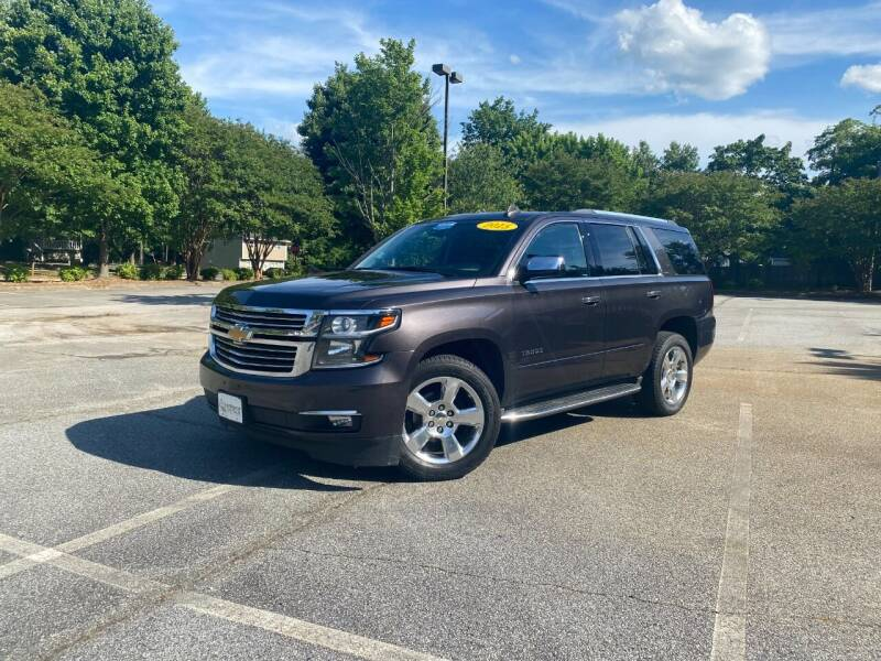 2015 Chevrolet Tahoe for sale at Uniworld Auto Sales LLC. in Greensboro NC