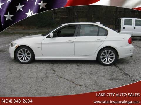 2011 BMW 3 Series for sale at LAKE CITY AUTO SALES in Forest Park GA