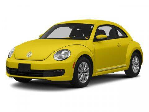 2013 Volkswagen Beetle for sale at HILAND TOYOTA in Moline IL
