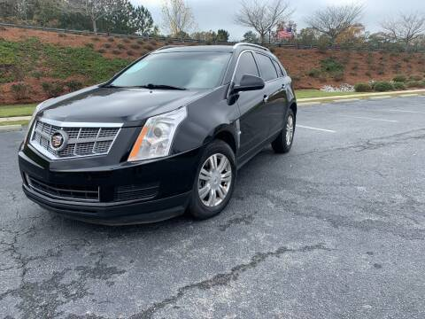 2011 Cadillac SRX for sale at Garcia Trucks Auto Sales Inc. in Austell GA
