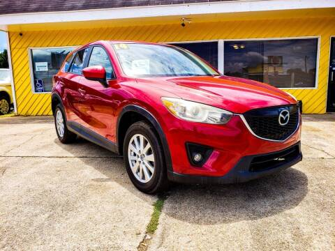 2014 Mazda CX-5 for sale at THE COLISEUM MOTORS in Pensacola FL
