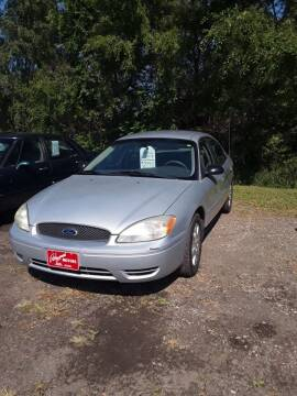 2004 Ford Taurus for sale at BARNES AUTO SALES in Mandan ND