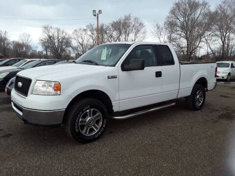 2006 Ford F-150 for sale at BARNES AUTO SALES in Mandan ND
