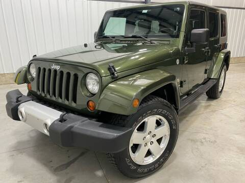 2009 Jeep Wrangler Unlimited for sale at EUROPEAN AUTOHAUS, LLC in Holland MI