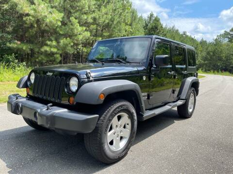 2012 Jeep Wrangler Unlimited for sale at Carrera AutoHaus Inc in Clayton NC