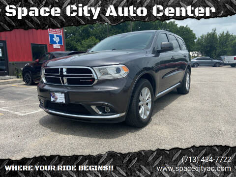 2015 Dodge Durango for sale at Space City Auto Center in Houston TX