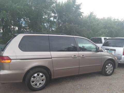 2003 Honda Odyssey for sale at BARNES AUTO SALES in Mandan ND