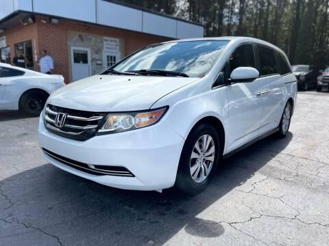 2014 Honda Odyssey for sale at Magic Motors Inc. in Snellville GA
