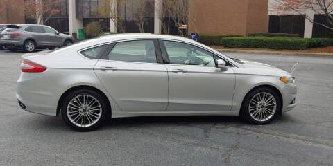 2014 Ford Fusion for sale at C & J International Motors in Duluth GA