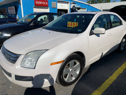 2009 Ford Fusion for sale at BURNWORTH AUTO INC in Windber PA