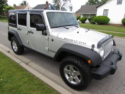 2012 Jeep Wrangler Unlimited for sale at First Choice Automobile in Uniondale NY