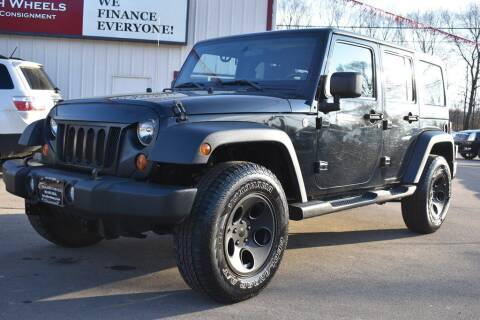 2011 Jeep Wrangler Unlimited for sale at Dealswithwheels in Inver Grove Heights MN