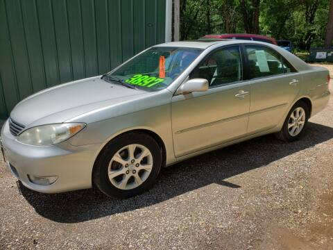 2006 Toyota Camry for sale at Northwoods Auto & Truck Sales in Machesney Park IL