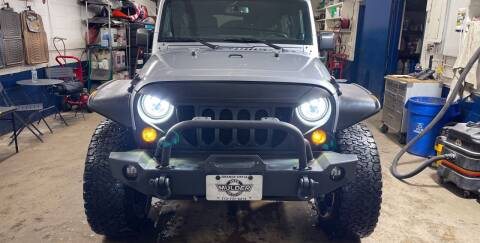 2014 Jeep Wrangler Unlimited for sale at Mulder Auto Tire and Lube in Orange City IA