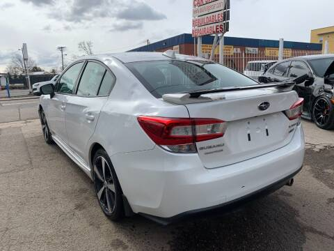 2017 Subaru Impreza for sale at STS Automotive in Denver CO