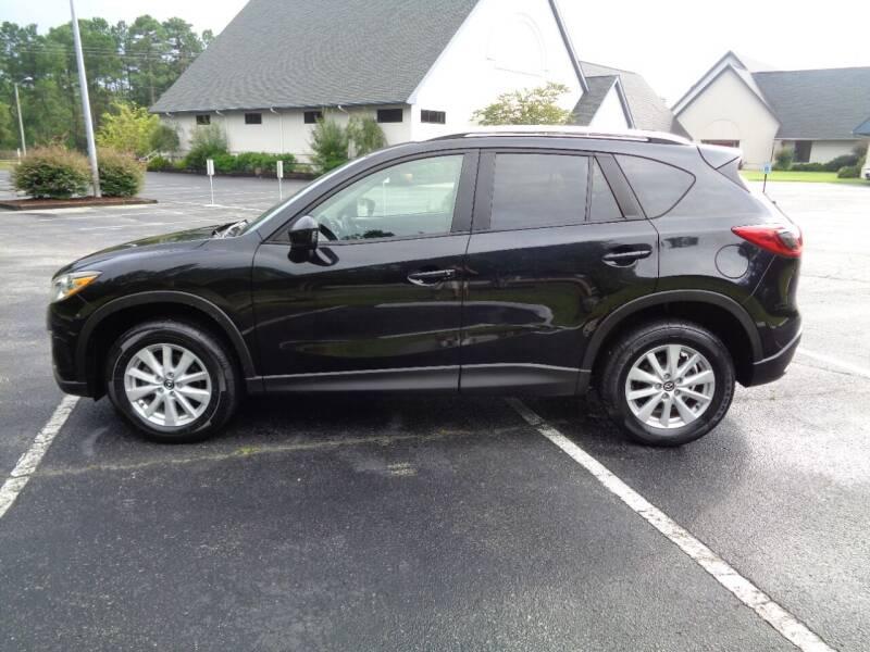 2014 Mazda CX-5 for sale at BALKCUM AUTO INC in Wilmington NC