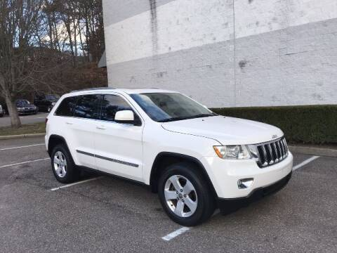 2011 Jeep Grand Cherokee for sale at Select Auto in Smithtown NY
