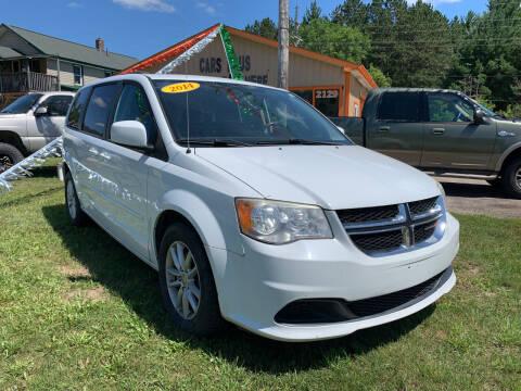 2014 Dodge Grand Caravan for sale at CARS R US in Caro MI