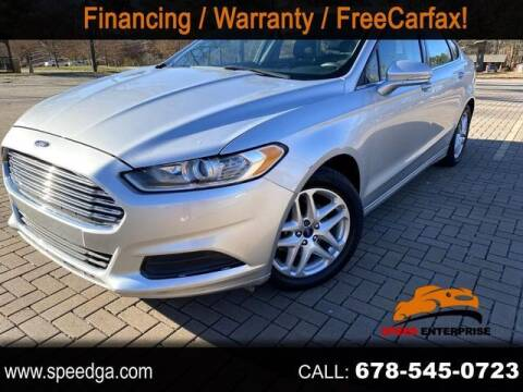 2014 Ford Fusion for sale at JES Auto Sales LLC in Fairburn GA