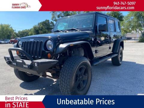 2010 Jeep Wrangler Unlimited for sale at Sunny Florida Cars in Bradenton FL