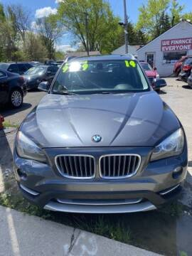 2014 BMW X1 for sale at Mastro Motors in Garden City MI