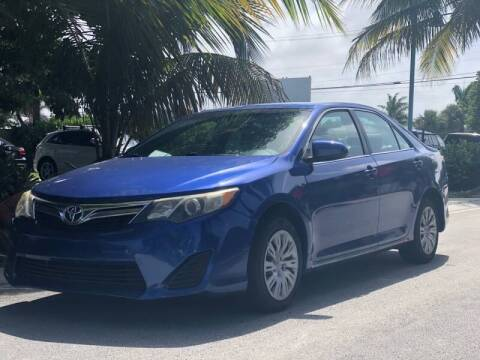 2014 Toyota Camry for sale at L G AUTO SALES in Boynton Beach FL