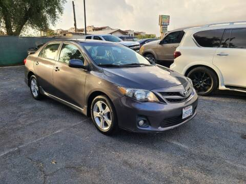 2013 Toyota Corolla for sale at E and M Auto Sales in Bloomington CA