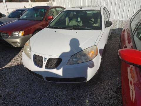 2009 Pontiac G6 for sale at PUTNAM AUTO SALES INC in Marietta OH
