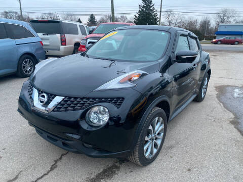 2015 Nissan JUKE for sale at Unique Auto Group in Indianapolis IN